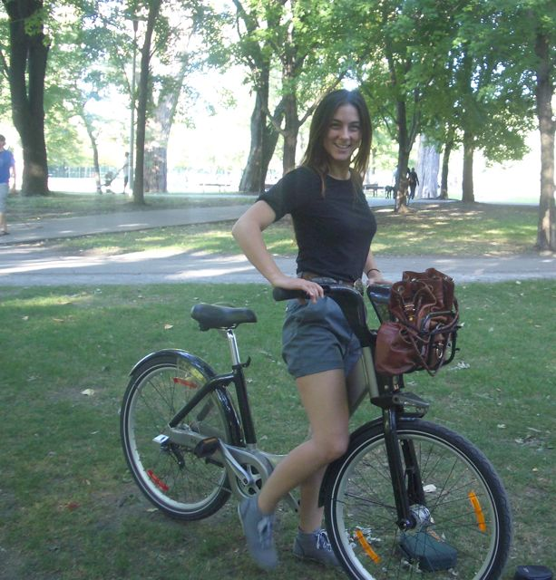 Rina drops in on our picnic riding her Bixi bike.