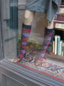 Took this picture from a Manhattan shop window (Rugby?). Aren't T-straps and argyle socks dazzling? So cute and preppy it makes me want to go back to school and get a PhD... in love.