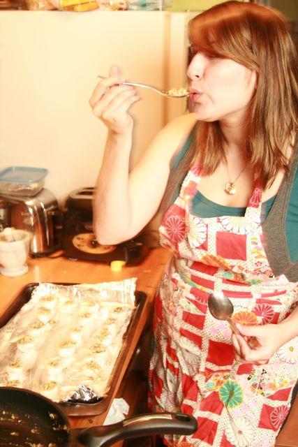 Alexandra taste tests yummy mushroom filling.